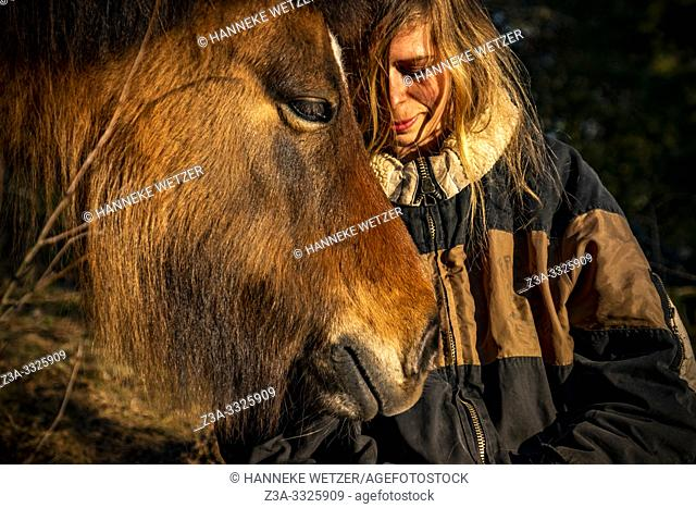 Portrait of a girl with her horse