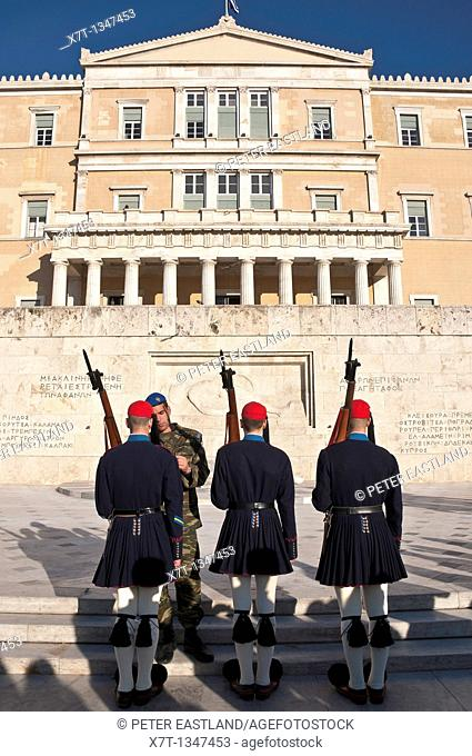 Evzones, an elite core of Greek soldiers used to guard the tomb of the unknown soldier infront of the Hellenic Parliament building in Syndagma Square in the...