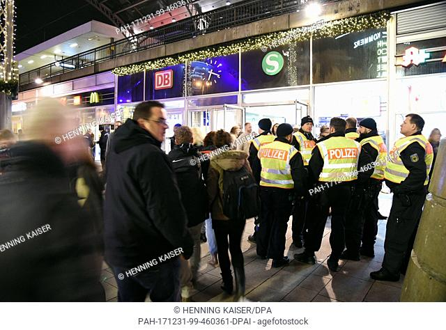 Policemen secure the area around entry of the central train station in Cologne, Germany, 31 December 2017. Great measures of security were taken this year...