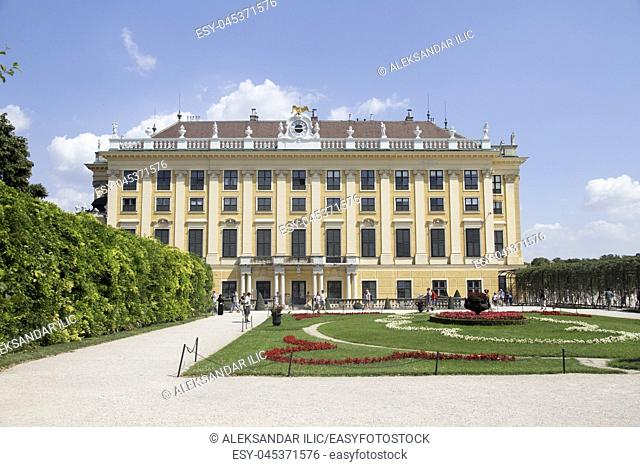 """Vienna, Austria - July 06 2018: """"""""Schonbrunn"""""""" palace (Schloss Schönbrunn) and the park with a blue sky and cloudsâ. """" Stock Editorial Photo"""