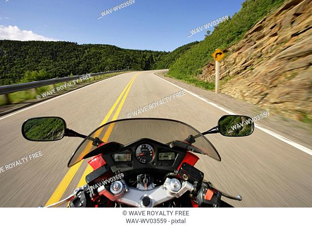 View on Motorcycle in action on Cabot Trail, Cape Breton Highlands National Park, Nova Scotia, Canada