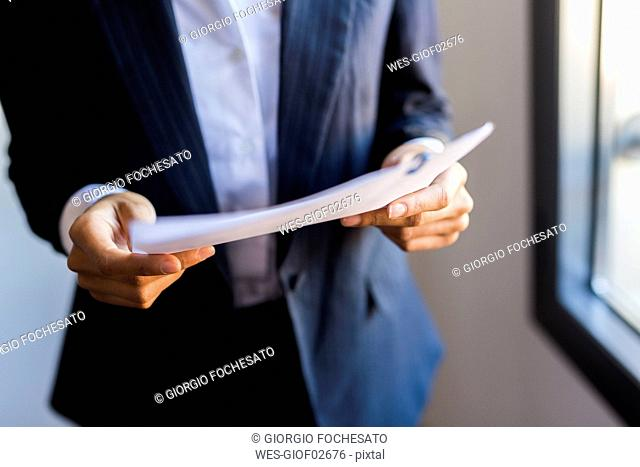 Close-up of businesswoman holding document