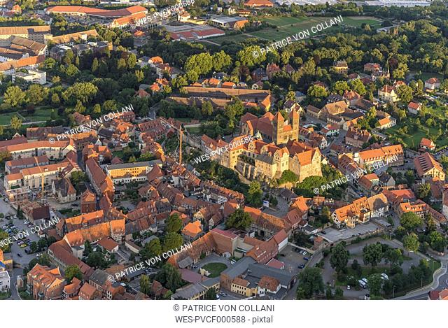 Germany, aerial view of Quedlinburg with collegiate church at evening twilight
