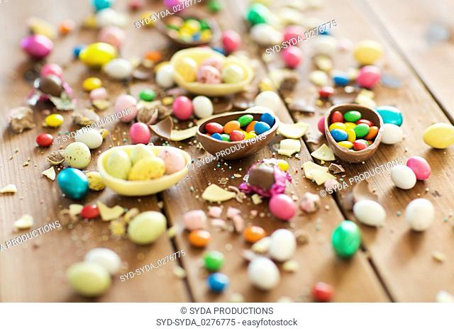 chocolate easter eggs and candy drops on table
