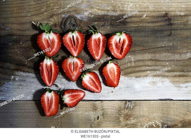 Picture about a cut sliced strawberries