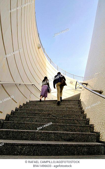 Couple climbing stairs, City of Arts and Sciences by Santiago Calatrava, Valencia. Comunidad Valenciana, Spain