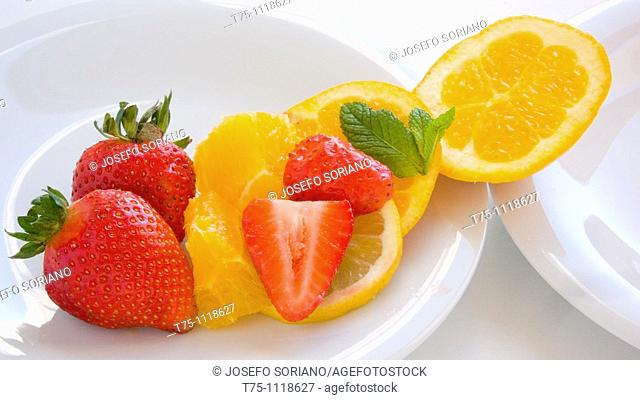 Orange, lemon, strawberries and mint leaves
