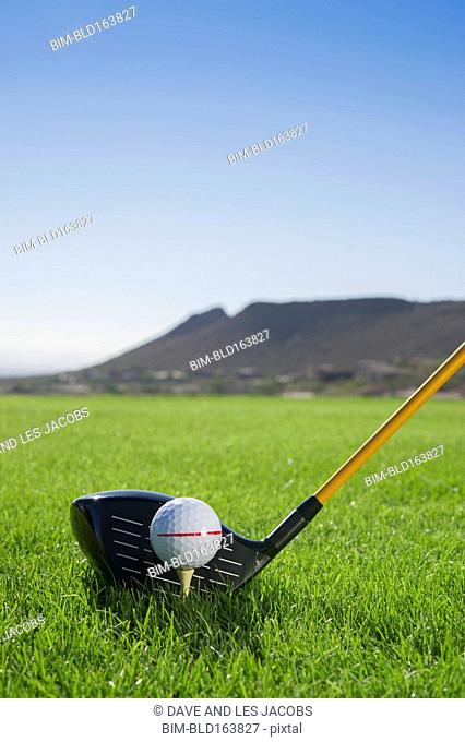 Close up of golf ball on tee and golf club