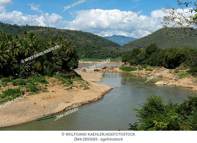 View of the Nam Khan River and a bamboo bridge near the confluence of the Nam Khan and Mekong Rivers at Luang Prabang in Central Laos