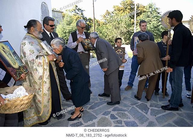 Tourists kissing religious pictures, Crete, Greece