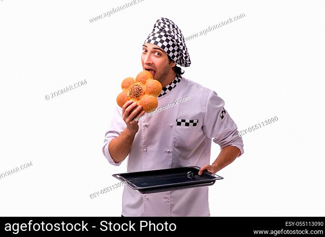 Young male baker isolated on white