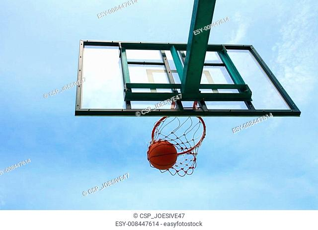 A basketball falls through the net