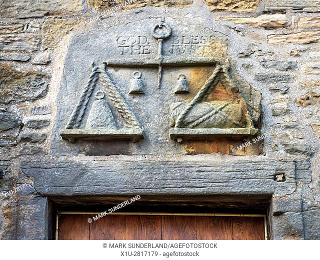 Stobe Carving of Scales with God Bless The Just Inscription at The Weigh House Fife Folk Museum Ceres Fife Scotland