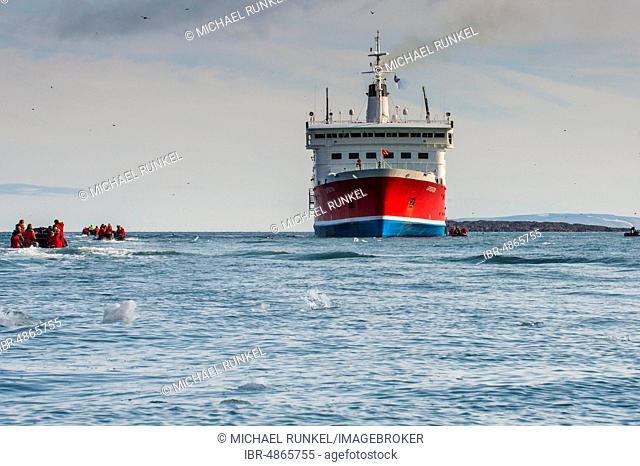 Tourist in zodiacs around a expedition ship, Torellneset, Arctic, Svalbard