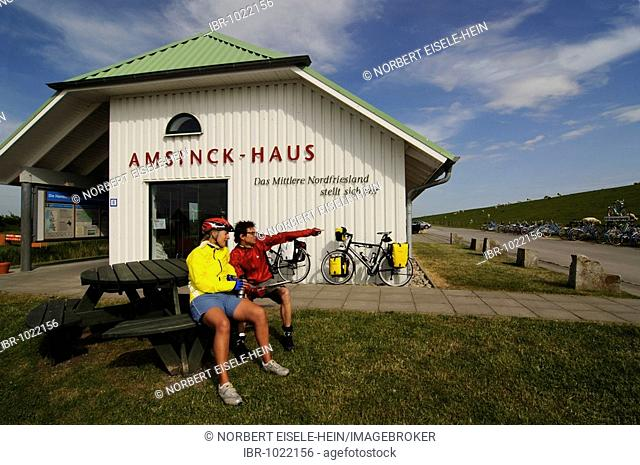 Cyclists at the Amsinck-Haus by Hamburger Hallig, North Frisia, North Sea, Schleswig-Holstein, Germany, Europe