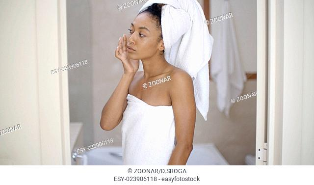 Woman Looking On The Mirror After Shower