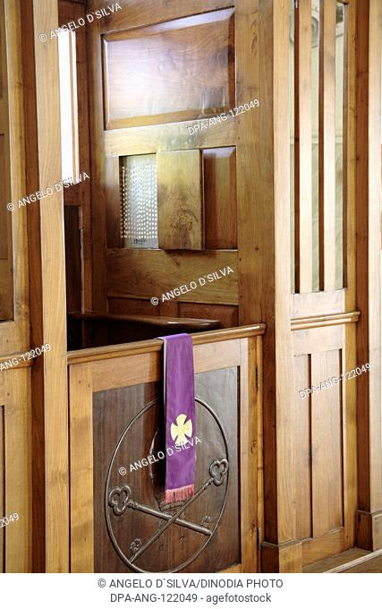Confession box and  purple stole cloth priest keeps on his chest in Church of Our Lady of Snow at Pallipport one of the most famous Marian pilgrimage centre in...