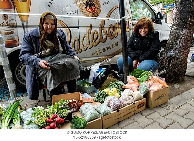 Down Town, Sofia, Bulgaria. Elder woman and her daughter selling groceries from crates in the streets, down town Sofia