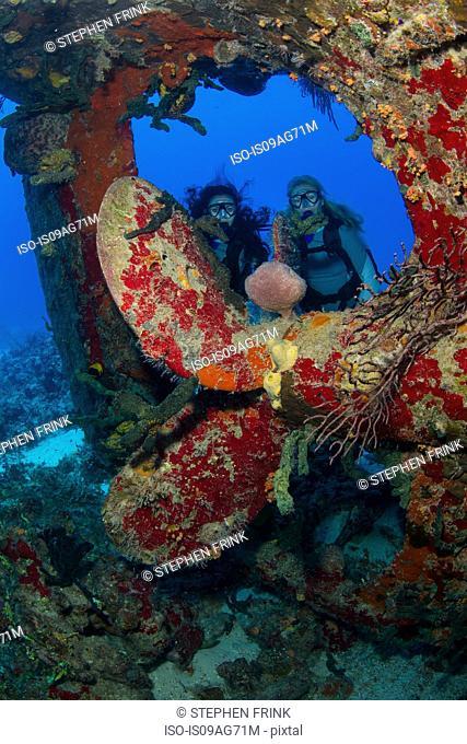Divers near prop of sunken ship