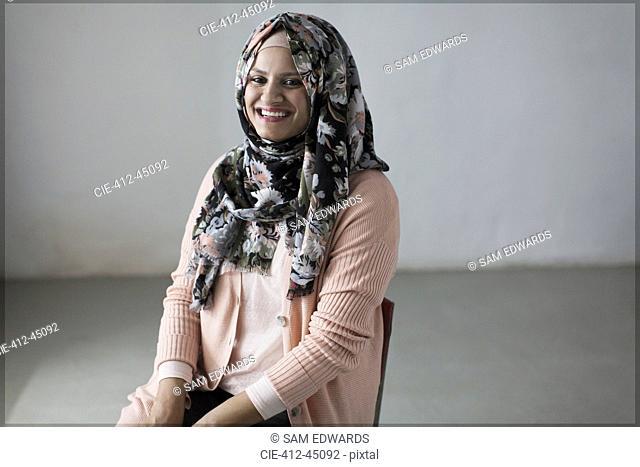 Portrait smiling, confident woman in floral hijab