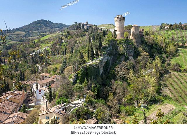 Towers of the fortress of Rocca Manfrediana, on rocks above the town, Brisighella, Emilia-Romagna, Italy