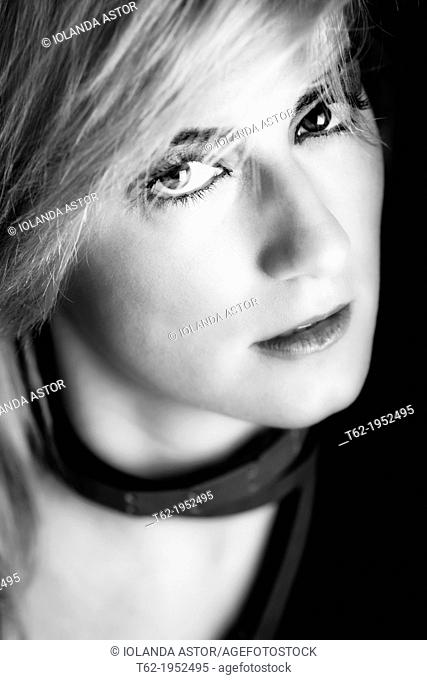 Close-up portrait of a beautiful young blonde. White and black