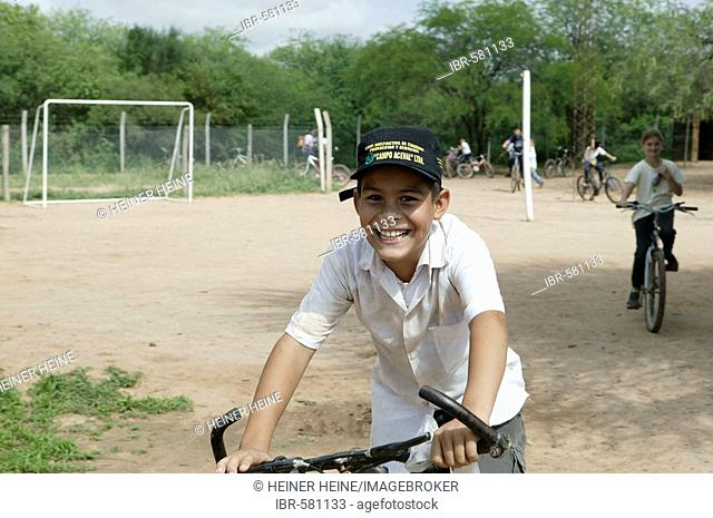 Boy with bicycle, Mennonite colony, Loma Plata, Chaco, Paragua, South America