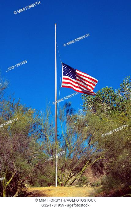 US flag at half-mast, to commemorate someone's death