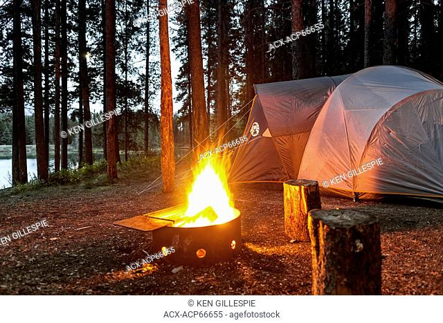 Campsite with burning campfire, Two Jack Lake, Banff National Park, Alberta, Canada