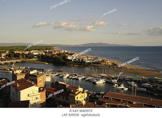 View over harbour and coastline in the evening sun, Castiglione della Pescaia, Maremma, Province Grosseto, Toskana, Italy, Europe