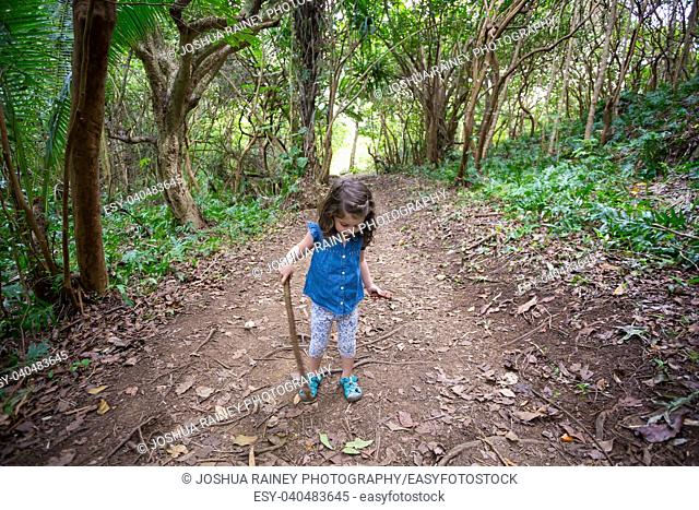 Three year old girl on the Hauula Loop Hiking Trail in Oahu Hawaii