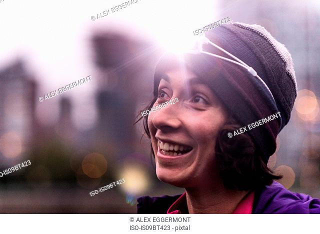 Runner with headlamp in urban North Vancouver, Canada
