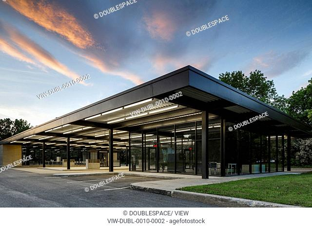 Mies van der Rohe Gas Station, Montreal, Canada. Architect: Architectes FABG, 2011. General view of the community centre at sunset