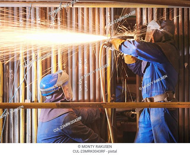 Workers cutting in a power station