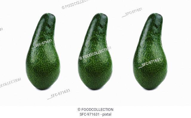 Three pear-shaped avocados