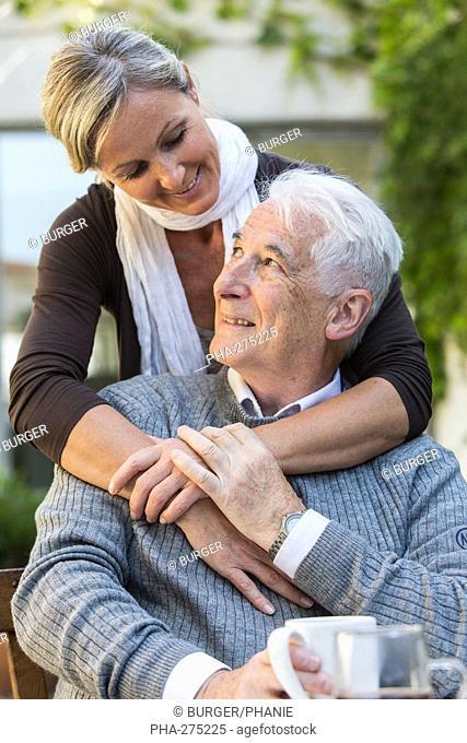 Woman assisting elderly man