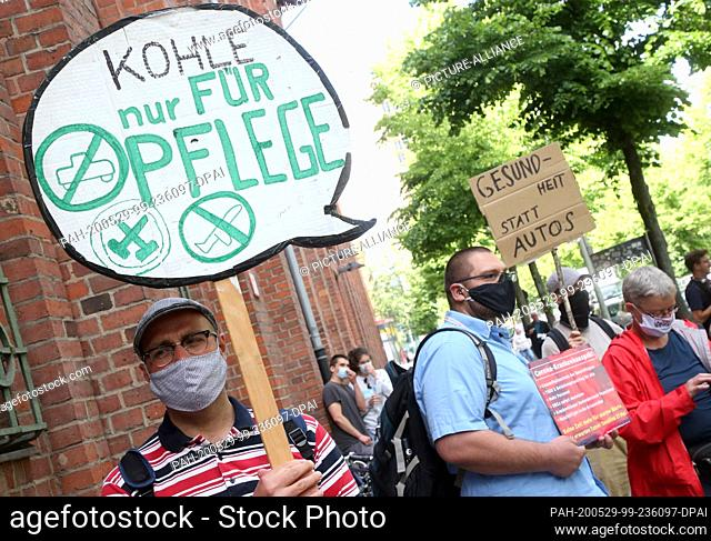 "29 May 2020, Berlin: People from various organizations protest against planned measures in connection with the corona pandemic during a rally """"Climate movement..."
