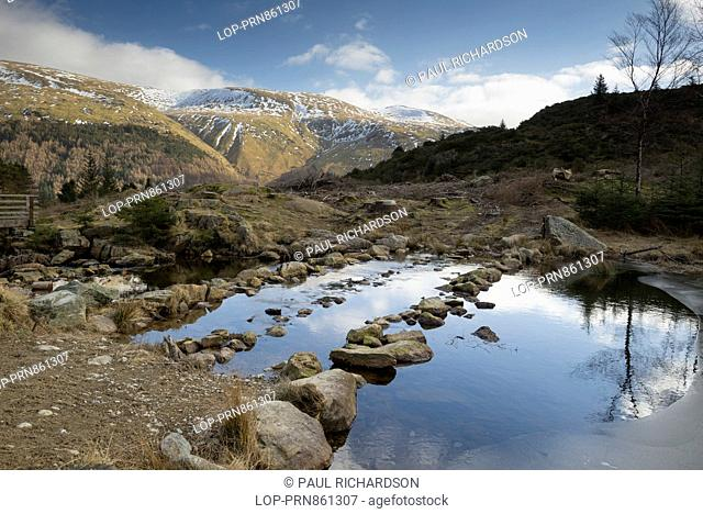 England, Cumbria, Lake District. A view across Harrop Tarn in the Lake District