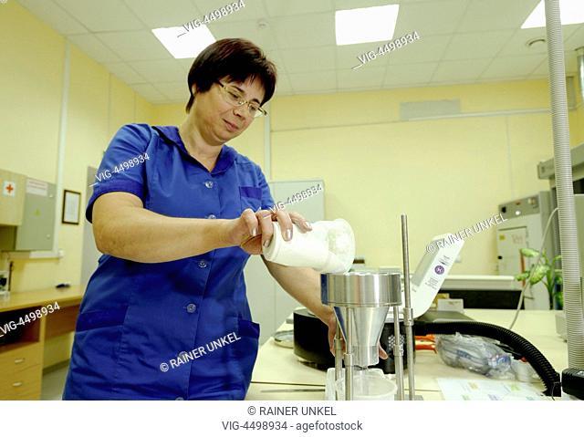 UKRAINE, KALINOVKA, 02.07.2014, UKR , UKRAINE : VEKA AG is producing window frames in Kalinovka : an employee in the lab is testing raw materials - Kalinovka