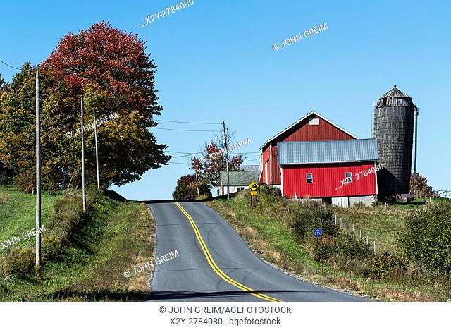 Country road and red barn, Oneida County, New York, USA