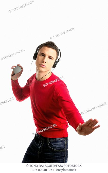 Young student boy dress in red hearing mp3 music, studio isolated on white
