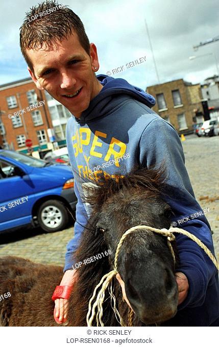 Republic of Ireland, Dublin, Smithfield Horse Market, A seller with his horse at Smithfield Horse Market in Dublin