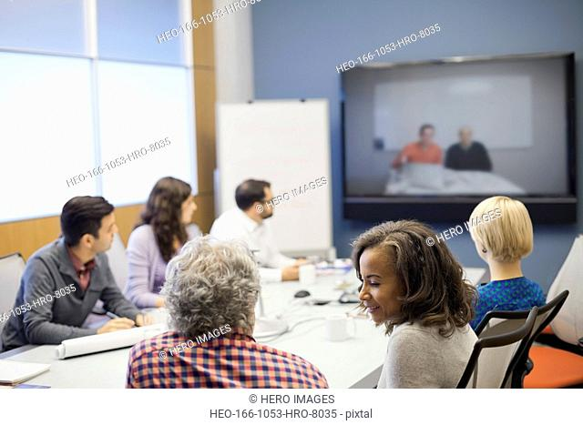 Business professionals sitting in video conference