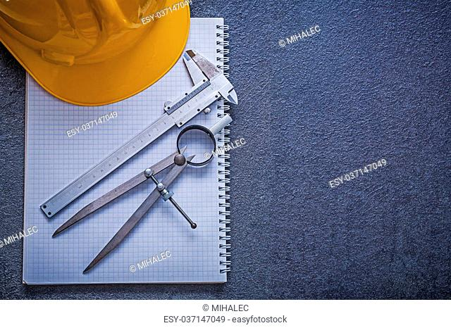 Copybook hard hat pair of compasses slide caliper construction concept