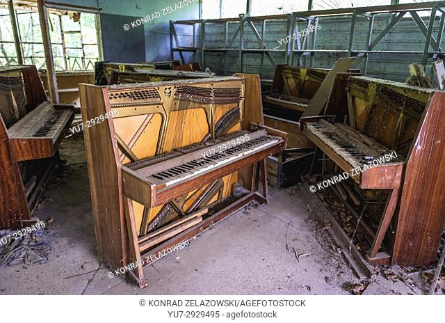 Old piano in abandoned music shop in Pripyat ghost city of Chernobyl Nuclear Power Plant Zone of Alienation around nuclear reactor disaster, Ukraine