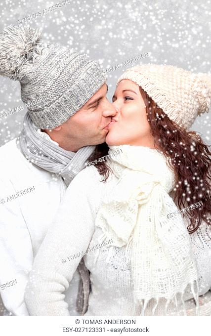 Young happy couple dressed in warm clothes in winter