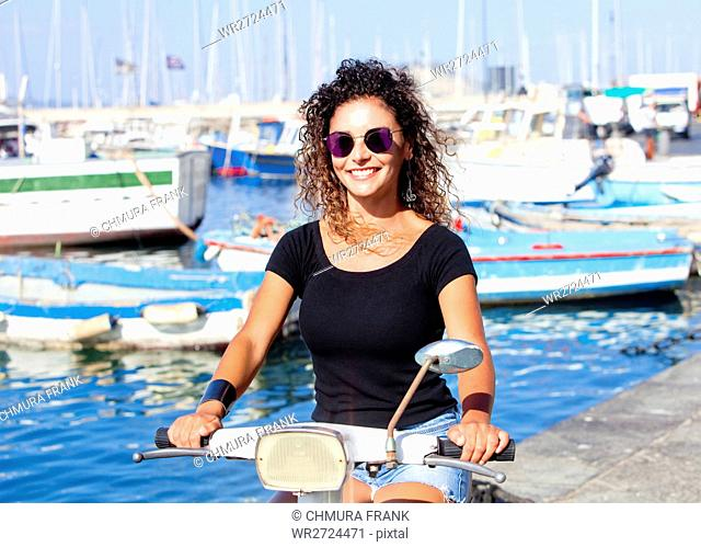 Young Italian Woman on Vespa Scooter Smiling