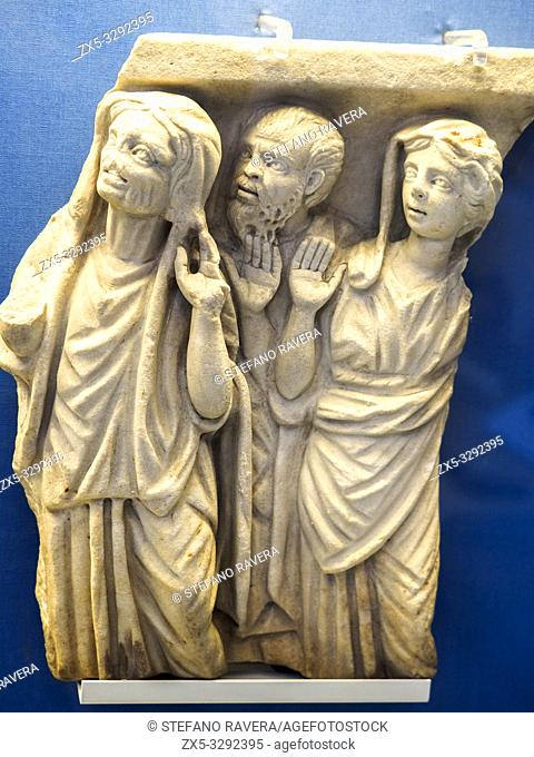 Part of a marble sarchophagus: three worshippers in Greek dress. Roman about AD 250-70. The old woman is derived from Hellenistic Greek genre figures
