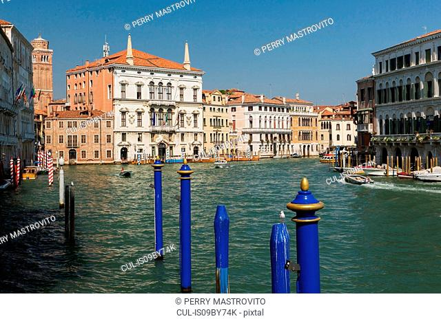 Blue mooring posts, water taxis on Grand Canal, Renaissance architectural style residential palace buildings, San Polo district, Venice, Veneto, Italy