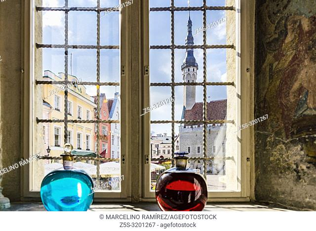 The town hall square seen from a pharmacy window. Tallinn, Harju County, Estonia, Baltic states, Europe